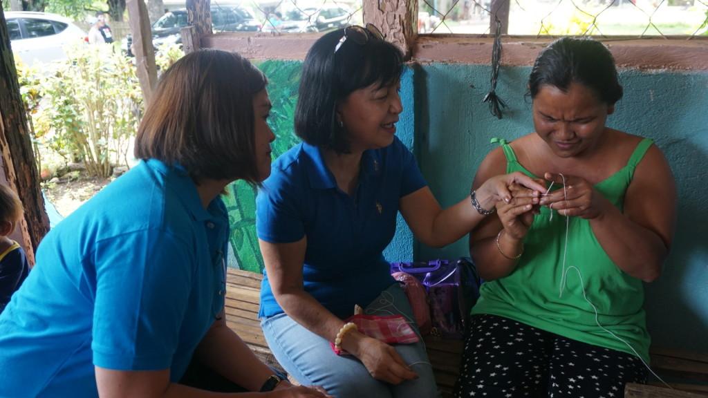 Rotarian Nenette teaching